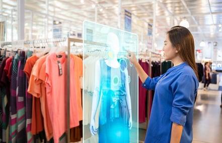 A girl virtually trying clothes through smart mirror