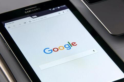 Google homepage open on a black Samsung tablet.