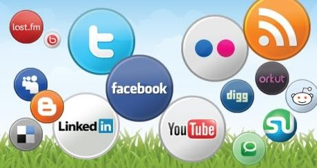 social media icons floating in green grass and blue sky